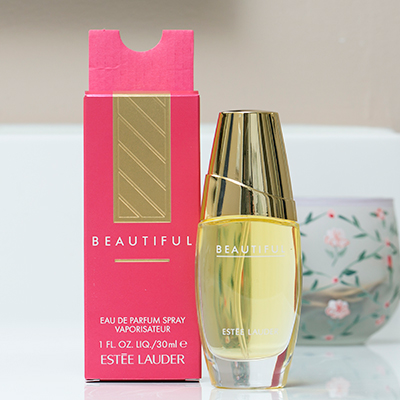 ESTÉE LAUDER<sup>®</sup> Beautiful Eau de Parfum Spray - The fragrance of a thousand flowers, this romantic, luxurious scent combines a bouquet of violets and lilies, roses and lilacs, marigold and orange blossoms and is warmed with a rich, woody base and brightened with a touch of citrus.  Spray bottle contains 1 fluid ounce of perfume.