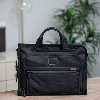 TUMI<sup>&reg;</sup> Alpha 3 Slim Deluxe Portfolio - This slim portfolio-style brief is well organized for your business or travel needs.  It features a zip-around opening for easy access to the main compartment. The interior features a padded tablet pocket, multiple pockets for accessories, and a magnetic slip pocket on the front.  Bag measures  12&quot;H x 16&quot;W x 3&quot;D.  Also features removable, padded shoulder strap and leather top carry handles.